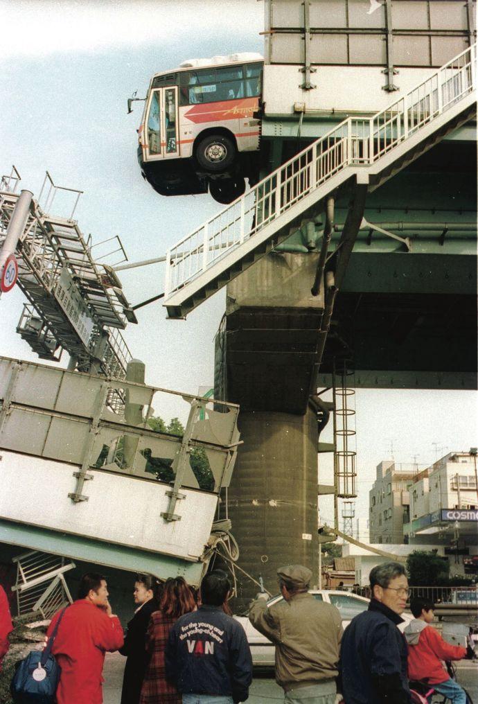 A bridge in Nishinomiya, Japan, fourteen miles from Kobe, after an earthquake struck on January 17, 1995.